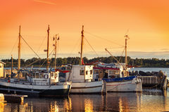 Fishing boat at Sunset. Norway Fishing Boat And Pier At Dusk Stock Photos