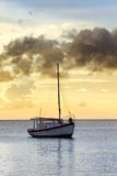 Fishing boat in sunset off Curacao coast Royalty Free Stock Photos