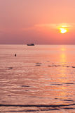 Fishing boat at sunset in the sea Royalty Free Stock Photography