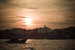 Fishing boat sunset at sichang Stock Photo