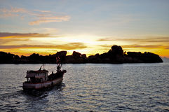 Fishing boat with sunset royalty free stock images