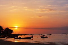Fishing boat and sunset Stock Image