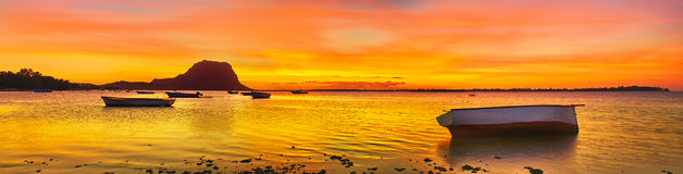 Fishing boat at sunset time. Le Morn Brabant on background. Pano Royalty Free Stock Image
