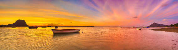 Fishing boat at sunset time. Le Morn Brabant on background. Pano Royalty Free Stock Photos
