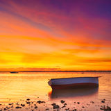 Fishing boat at sunset time Stock Photo