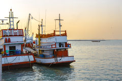 Fishing boat in sunset time Royalty Free Stock Images