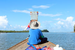 Fishing boat thailand. A boy in fishing boat go to the sea at blue sky of the day stock images