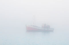 Fishing boat in thick mist Royalty Free Stock Photography