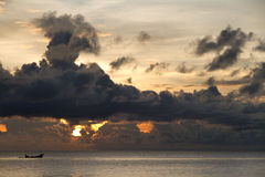 Fishing boat with threatening clouds. Over South China Sea at Phu Quoc, Vietnam Stock Photos