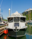 A fishing boat tied to a floating dock in alaska Royalty Free Stock Photos