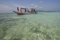 Fishing boat. Tourists rent a fishing boat on an island in Jepara, Central Java, Indonesia Royalty Free Stock Image