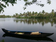 Fishing Boat. Traditional Kerala fishing boat idling in the backwaters royalty free stock photo