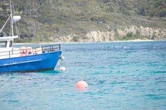 Fishing boat trawler anchoring at port Stock Images