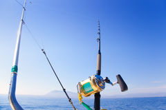 Fishing boat trolling with outrigger gear Stock Photo