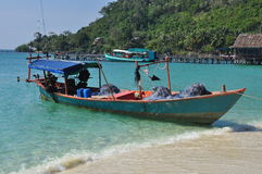 Fishing boat on a tropical beach, Koh Rong, Cambodia. Koh Rong island, Cambodia. Traditional wooden fishing boat on a tropical white beach Royalty Free Stock Images