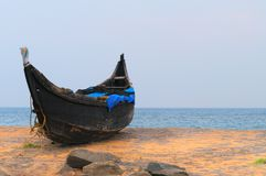 Fishing Boat on Tropical beach. In Kovalam. Kerala. India stock photography