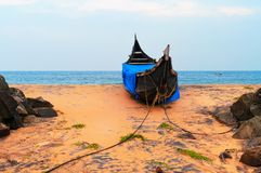 Fishing Boat on Tropical beach. In Kovalam. Kerala. India royalty free stock photos