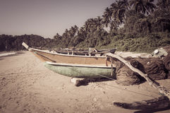 Fishing boat on a tropical beach  Royalty Free Stock Photography