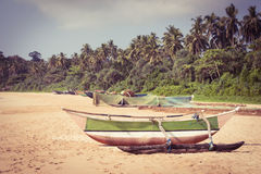 Fishing boat on a tropical beach Stock Images