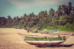 Fishing boat on a tropical beach Stock Photos