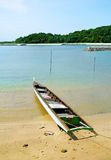 Fishing boat on tropical island beach stock image