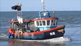 Fishing boat tug coming into harbour
