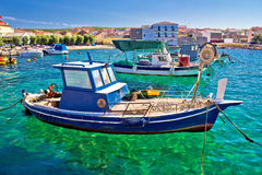 Fishing boat on turquoise sea Stock Image