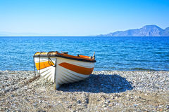 Fishing boat. View of a small fishing boat on a pebble beach Royalty Free Stock Image