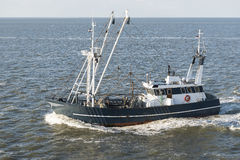 Fishing boat on Wadden Sea Royalty Free Stock Photography