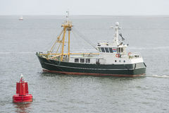 Fishing boat on the Wadden Sea Royalty Free Stock Image