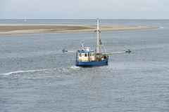Fishing boat on the Wadden Sea Stock Photo