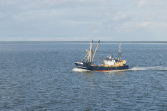 Fishing boat on the Wadden Sea Royalty Free Stock Images