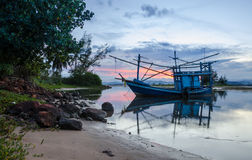 The fishing boat was stopped work near bay. Stock Photography