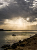 Fishing boat on the water. Dramatic weather Royalty Free Stock Photography