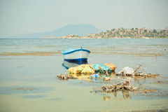 Fishing boat on the water of drying lake Bafa with pollution by garbage Stock Photography