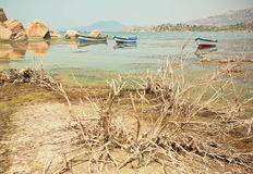 Fishing boat on the water of drying lake Buf, rural Turkey. Royalty Free Stock Images