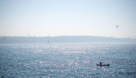 Fishing boat in the waters of sea Stock Photos