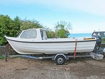 Fishing Boat white on a trailer concrete yard. fish