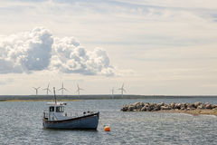 Fishing Boat by Wind Power Stations. Stock Photos