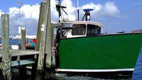 Free Fishing Boat With Green Hull At Dock Stock Photos - 158205473