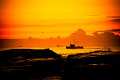 Fishing boat, Wollongong. A fishing boat cruises by the shore at dawn in Wollongong, NSW, Australia Stock Images