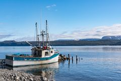 Fishing Boat in Woody Point Fishing Village in Newfoundland. Fishing trawler docked at Woody Point Fishing Village in Gros Morne, Newfoundland, Canada royalty free stock photo