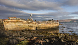 Fishing boat wrecks at Salen on the Isle of Mull. Fishing boat wrecks at Salen on the Isle of Mull in Scotland Royalty Free Stock Photos