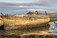 Fishing boat wrecks at Salen on the Isle of Mull. Fishing boat wrecks at Salen on the Isle of Mull in Scotland Royalty Free Stock Photo