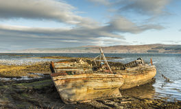 Fishing boat wrecks at Salen on the Isle of Mull. Fishing boat wrecks at Salen on the Isle of Mull in Scotland Royalty Free Stock Image