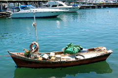 Fishing boat and yachts. Poor fishing boat and yacht in Punta del Este Port.  Uruguay Stock Photos