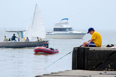 Fishing and boating on lake michigan Royalty Free Stock Image