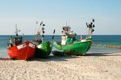 Fishing boats. On the sea shore - sand Royalty Free Stock Photos