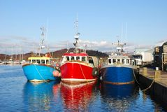 Fishing Boats. Trawlers at quayside, Tarbert, west coast of Scotland Stock Photos