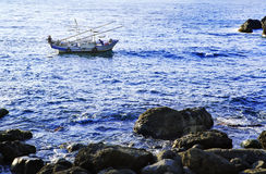Fishing boats. Fisherman fishing vessels fishing in the sea Stock Photography